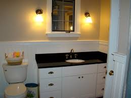 incredible white bathroom vanity with black top related to home