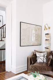 our sofa collab is on sale at interior define the everygirl caitlin chair in quartz velvet by alaina kaczmarski