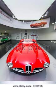 a superb alfa romeo 1900 c52 disco volante model on display at the