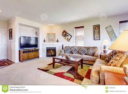 Livingroom Fireplace White Living Room With Fireplace And Colorful Rug Stock Photo