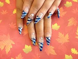 stiletto nails with blue and white nail art nail designs for you