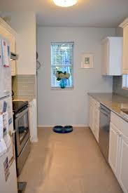 Blue Granite Floor Tiles white kitchen with light blue backsplash and azul platino granite