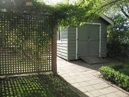endearing garden decoration using light grey wood garden shed