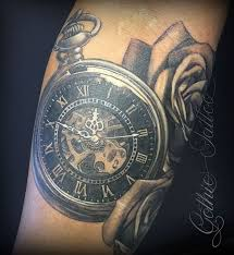 pocket watch with roses tattoo on arm by gothic tattoo uk