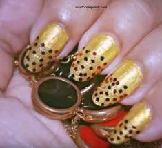 red gold nail design with glitter and nail polish love for