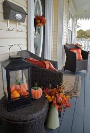 fall porch decorating mums in bushel baskets and hay for the