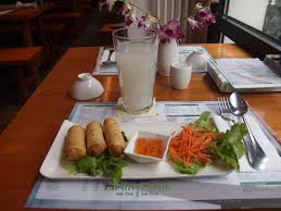 lychee juice file spring rolls and lychee juice at restaurant nam nam in munich