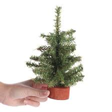 small artificial pine tree trees and toppers