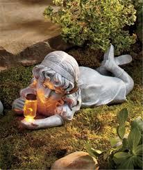 nostalgic boy and or garden statues w solar firefly in glass