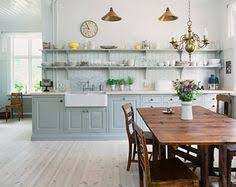 love the cabinet color with the butcher block and white