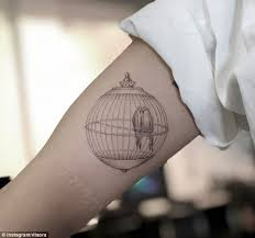 ora adds to collection of tattoos daily mail