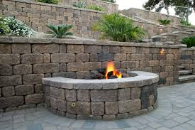 cool keystone country manor fire pit built into a country manor