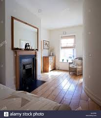 wooden mirror above fireplace in bedroom of macclesfield townhouse