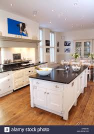 island unit in modern white country kitchen with white aga oven