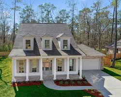 new orleans style home plans audubon side load garage sunrise homes new in orleans style home