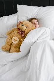 Bed Eyes Photo Of Little Cute Boy Sleeping With Teddy Bear In Bed Eyes