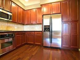 cabinet doors that slide back sauder storage cabinet top familiar colors for kitchen with oak