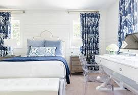 white and blue bedroom with ikat curtains transitional bedroom