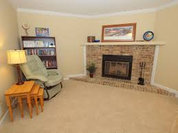 traditional living room with carpet u0026 metal fireplace in fairfax