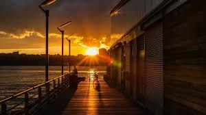 sunsets fisherman world pier warehouse river sunset city