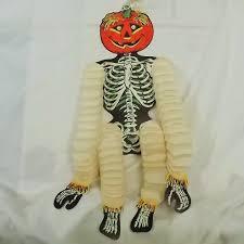dancing skeleton with jack o lantern head hanging halloween