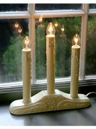 swedish candles in every swedish window all during the