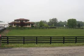 luxury equine estate with indoor outdoor arena and prairie style