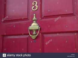Brass Door Furniture On A Red Door Stock Photo Royalty Free Image - Red door furniture