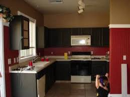 Black Kitchen Cabinets by Black Kitchen Cabinets With Red Walls Video And Photos