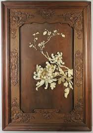 carved wood framed wall a pair japanese ivory and wood wall hangings meiji period 19th c