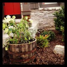 Half Barrel Planters by How To Prepare Half Whiskey Wine Barrel Planter Our First Cottage