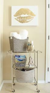 how to organize the master bathroom in style polished habitat bathroom storage solutions add a small tiered cart and baskets to hide bathroom clutter