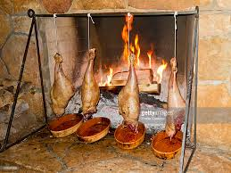 legs of lamb roast in front of a fireplace during the fireside