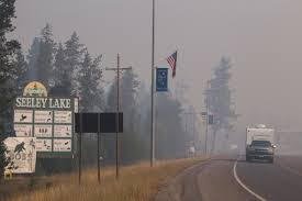 Wildfire Near Missoula by Residents Of Smoke Choked Montana Town Advised To Leave Montana