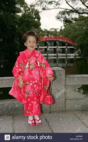 young japanese in traditional kimono yukata dress waiting for