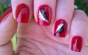 life world women elegant red nails with feather nail design