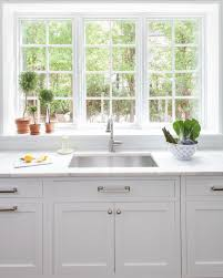 kitchen window sill ideas beautiful kitchen features white shaker cabinets paired with