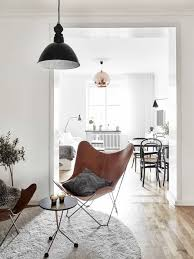 scandinavian apartment designed with white walls and hanging