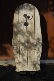 scary ghost made from pallet wood has little black shoes too who