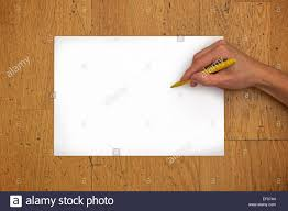 writing position paper hand holding pen on a blank white paper sheet in horizontal stock hand holding pen on a blank white paper sheet in horizontal position on a