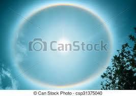 circular rainbow around sun with clouds stock photo search