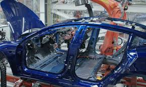 tesla model 3 delays due to battery module assembly line