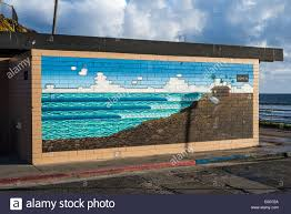 mural on a wall of a public restroom at tourmaline surf park san mural on a wall of a public restroom at tourmaline surf park san diego california united states