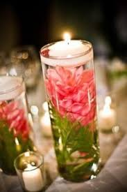 Wedding Centerpieces Floating Candles And Flowers by Rent Three Different Size Vases And Fill With Silk Orchids And