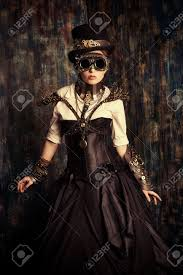 steampunk halloween background portrait of a beautiful steampunk woman over grunge background