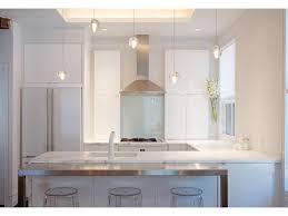 White Kitchen Glass Backsplash Marble Glass Cabinets Stainless Steel Appliances Wood Floors
