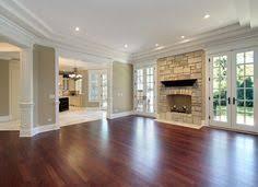 this dark brazilian cherry hardwood floor has been refinished by