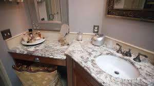 antico granite countertops in a classic bathroom