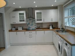 White Inset Kitchen Cabinets by Howdens Burford White Shaker Kitchen With Oak Laminate Worktop