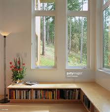 living room with low bookshelves stock photo getty images